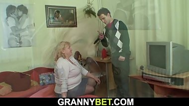 Hungry big tits grandma swallows his cock before riding