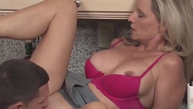 Gorgeous mature woman with big tits seduces and fucks young boy