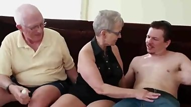 Crazy mature couple having fun with young stud during vacation