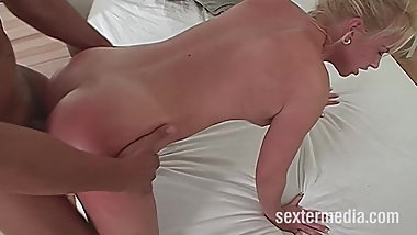 Mature blonde with natural tits