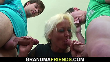 Blonde granny teacher double penetration in the classroom