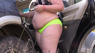 BBW with big ass changes panties near a car outdoors