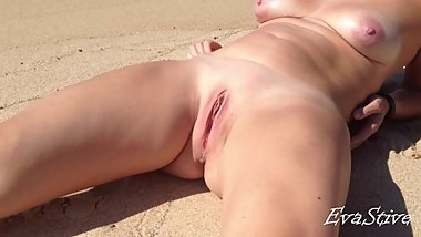 shaved babe pissing lying on the beach