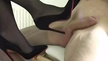 Naughty mature bitch using her sexy stilettos on a rock hard dick