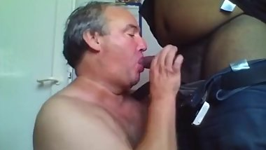 Tattooed ass daddy gets a black dildo and then sucks black man's cock