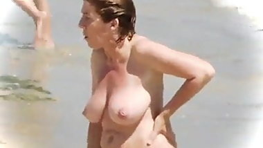 Mature Woman with Incredible Huge Tits on the Beach