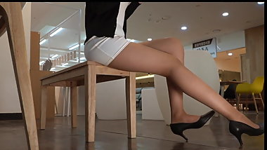 Office lady legs in tan pantyhose and heels