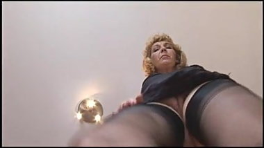 Mature gives upskirt show
