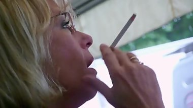 Smoking Candid 01 - Blonde mature limits air to her lungs