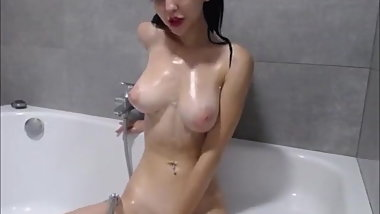 brunette with gorgeous boobs masturbates in the bath
