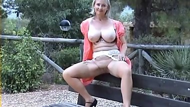 Busty mature Michelle flashing